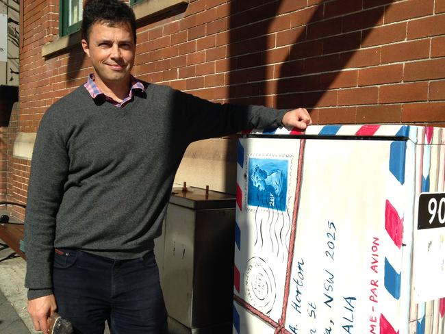 Adam Long with one of his traffic signal box designs. Picture: Jenifer Jagielski