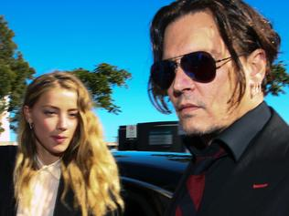 "(FILES) This file photo taken on April 17, 2016 shows US actor Johnny Depp (R) and his wife Amber Heard as they arrive at a court in the Gold Coast. Johnny Depp's wife has filed for divorce, citing irreconcilable differences after 15 months of marriage to the Hollywood star, celebrity news media reported on May 25, 2016. Court records published by the TMZ website show that Amber Heard submitted the petition to a court in Los Angeles on Monday seeking spousal support from the 52-year-old ""Pirates of the Caribbean"" star. The separation comes less than a week after the death of Depp's mother, Betty Sue Palmer, at the age of 81. / AFP PHOTO / Patrick HAMILTON"