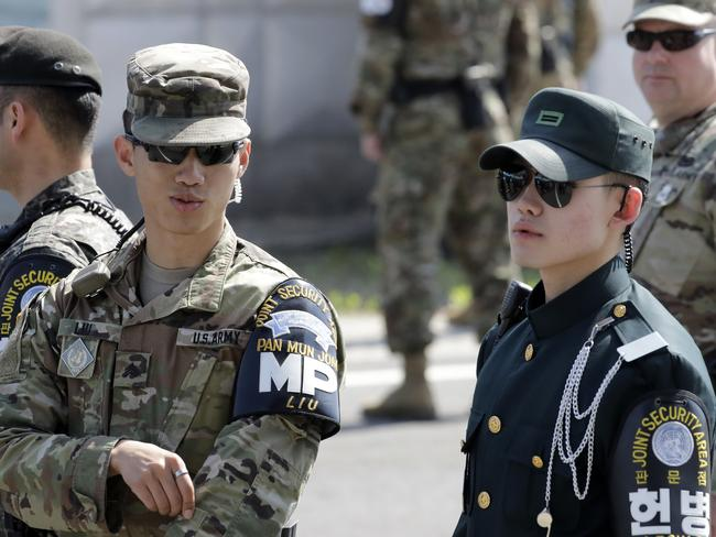 South Korean and U.S. soldiers stand in the southern side during a press tour at the border village of Panmunjom in the Demilitarized Zone, South Korea. Picture: AP