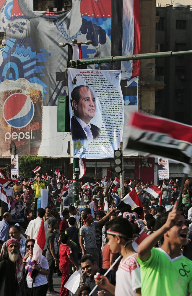 Crowd gathers ... supporters of Egypt's new President celebrate his inauguration in Tahrir Square.