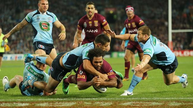 Sam Thaiday drops the ball over the line. Picture: Mark Evans
