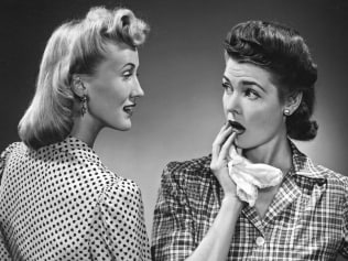 A woman expresses shock and surprise at what her friend has just said, circa 1956. (Photo by Underwood Archives/Getty Images)