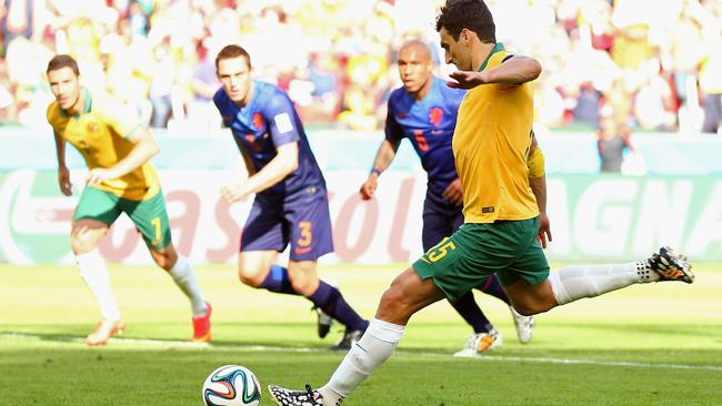 Mile Jedinak of Australia shoots and scores his team's second goal from the penalty spot.
