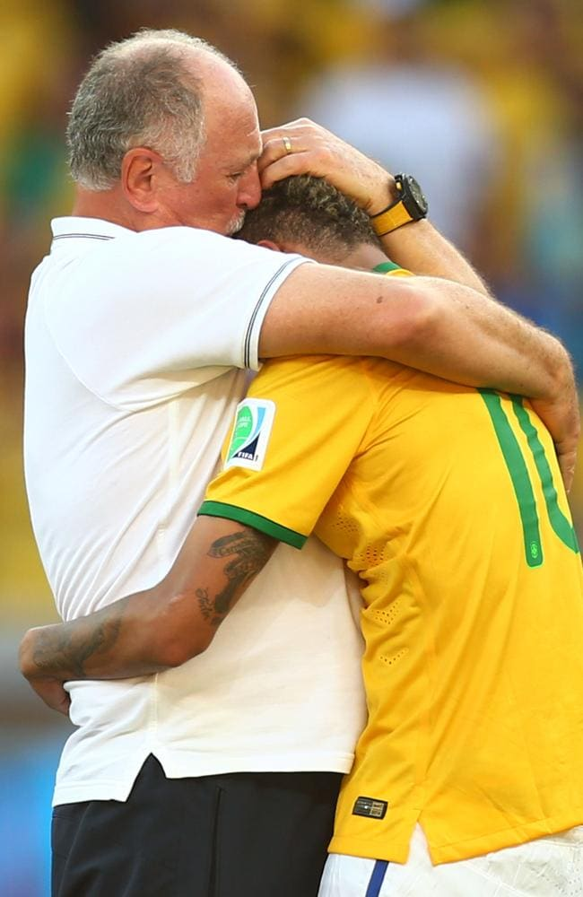 Brazil coach Luiz Felipe Scolari celebrates with Neymar after defeating Chile in a penalty shootout in the World Cup 2014 round of 16.
