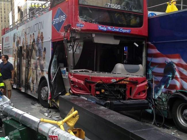 Close call ... Emergency personnel respond to a collision between two double-decker buses on New York City's Times Square.