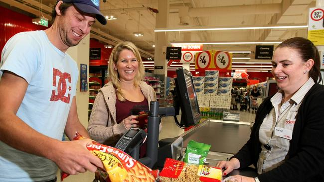 Nathan and Andrea Tinkler pack their own groceries at Coles in Southland. Picture: Ian Currie