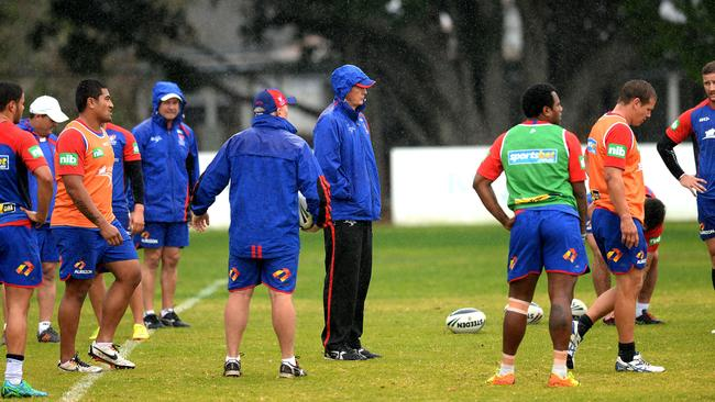 Knight's coach Wayne Bennett at training in the rain.