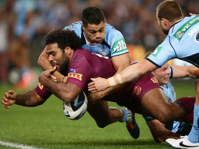 NSW Blues fullback Jarryd Hayne knocks the ball from the grasp of Queensland forward Sam Thaiday in State of Origin II.