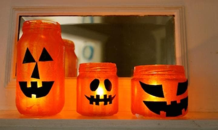 "26. Jack-o 'lantern jars  <p>Line these up along the front path to light the way to Spooksville. Don't forget the tealights!</p> <p><a href=""http://www.kidspot.com.au/things-to-do/activities/jack-olantern-jars"">See here for how to make Jack-o 'lantern jars.</a></p>"