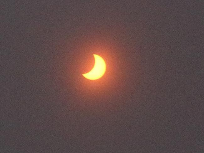 A partial solar eclipse is seen over Darwin. Picture: AAP