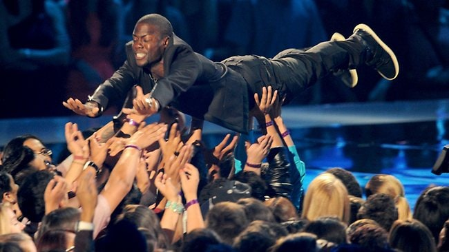 Comedian Kevin Hart dives off-stage during the 2012 MTV VMAs. Picture: Getty Images