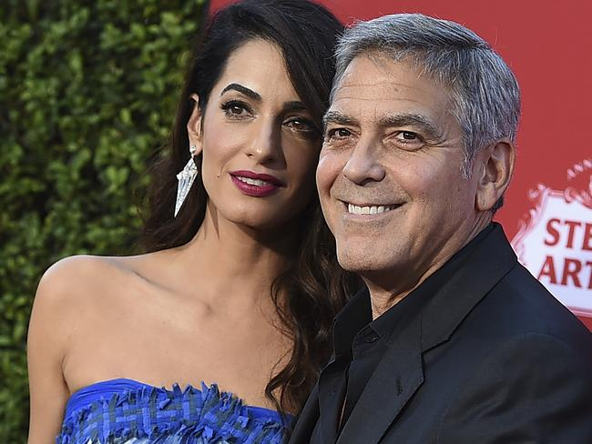 George and Amal Clooney will march in the rally. Picture: Jordan Strauss/Invision/AP