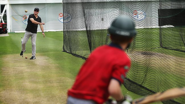 Austin Waugh in the SCG nets with his famous dad, Steve, yesterday. Picture: Brett Costello