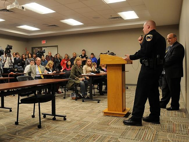 Horrifying details ... Capt. Markeson, flanked by Waseca School Superintendent Thomas Lee, answers questions.