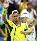 <p>Tennis player Lleyton Hewitt with daughter Mia after his win in the Davis Cup Asia-Oceania group playoff match in Townsville.</p>