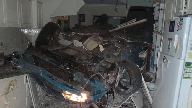 The mangled wreck of a Holden Commodore inside a couple's kitchen after a horrific accident in the Wheatbelt. Picture supplied by WA Police.