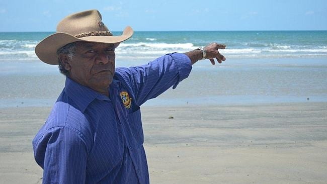 IDYLLIC: Yarrabah councillor Henry Miller on the beach. Pic: Des Houghton