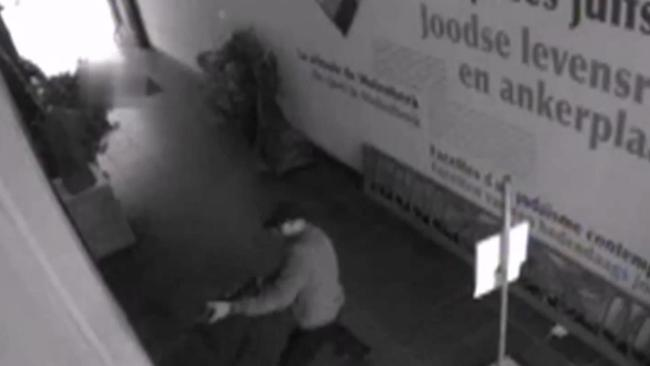 Moment of truth ... the footage shows the suspect pulling an AK-47 out of a bag and shooting. Picture: Federal Police of Belgium