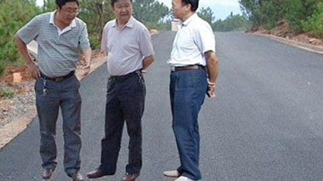 """Officials """"inspecting"""" a road at Lihong. Picture: Huili County Government"""