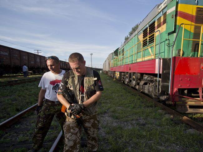 Destination unknown ... Armed rebels forced emergency workers to hand over all 196 bodies recovered from the Malaysia Airlines crash site and had them loaded yesterday onto refrigerated train cars bound for a rebel-held city, Ukrainian officials and monitors said.