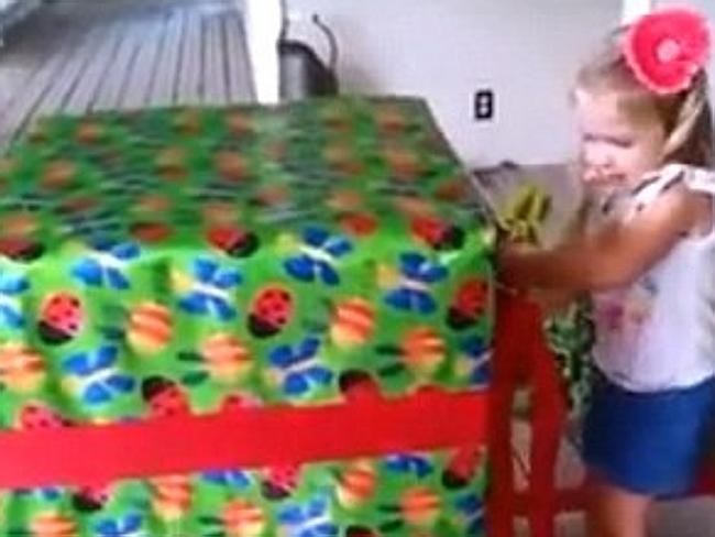 Bridget is given a massive wrapped box for her birthday.