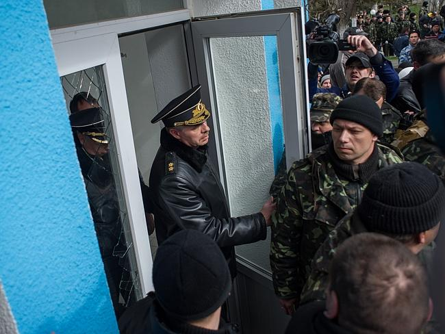 Escalation...Chief of the Russian Black Sea Fleet Alexander Vitko leaves the Ukrainian navy headquarters after they were seized by pro-Russian forces in Sevastopol, Crimea. Picture: AP