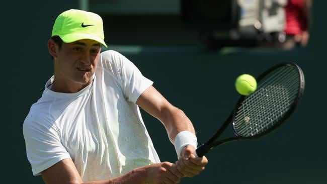 Bernard Tomic of Australia plays a backhand against Andy Murray of Great Britain during their second round match at the Sony Open at Crandon Park Tennis Center on March 23, 2013 in Key Biscayne, Florida. Picture: Getty