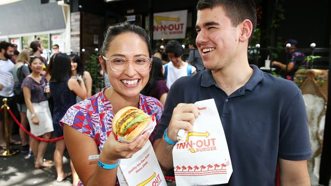 PMasaya Arellano and Haris Kruskic enjoying the In 'n' Out Burger Pop Up at Dead Ringer in Surry Hills yesterday.