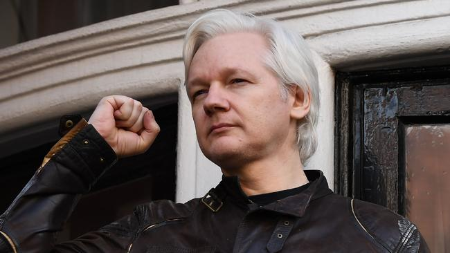 Wikileaks founder Julian Assange raises his fist prior to addressing the media on the balcony of the Embassy of Ecuador in London on May 19, 2017.