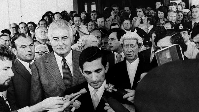 Prime Minister Gough Whitlam on the steps of Parliament House as Govt House official secretary David Smith reads the proclamation dissolving parliament Nov. 11 1975. Photograph from the Canberra Times.