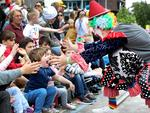4-year-old Jasper Fleming has an exciting encounter with a clown during the 2017 Adelaide Christmas Pageant. AAP Image/Dean Martin