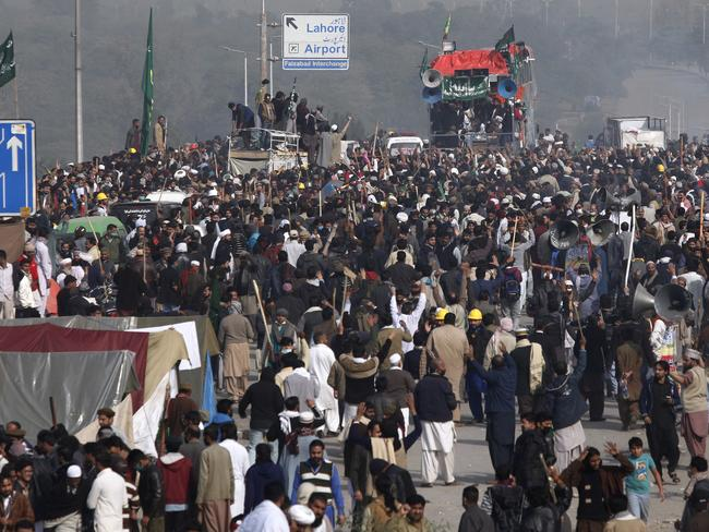 Protesters express their supports to their leadership after clash with police, in Islamabad, Pakistan. Picture: AFP