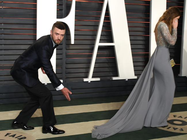 Justin Timberlake looks to be in a playful mood on the red carpet, leaving Jessica Biel looking a little embarrassed. Picture: Evan Agostini/Invision/AP