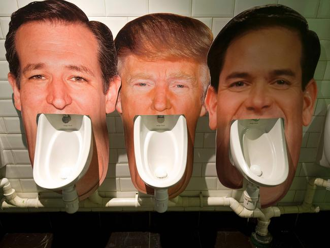 Cardboard cut-outs of 2016 US Presidential hopefuls (from left) Ted Cruz, Donald Trump and Marco Rubio on urinals in a pub in London as part of an informal poll for customers to log which they dislike the most.