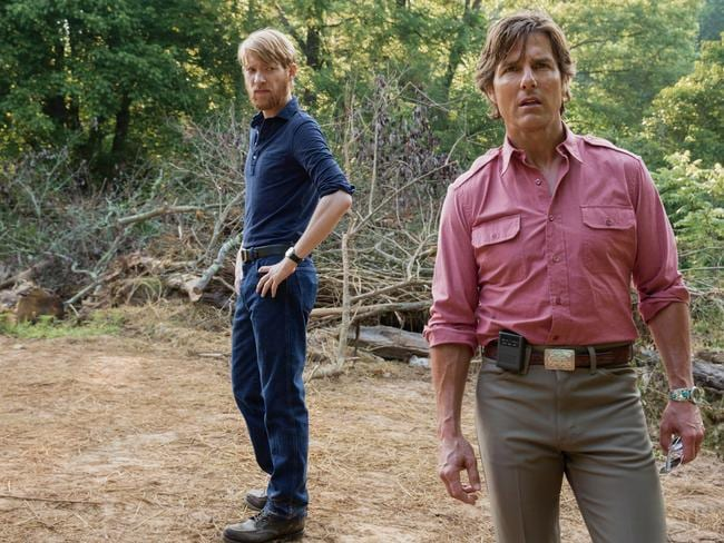 Tom Cruise as pilot Barry Seal and Domhnall Gleeson as his CIA handler in American Made.