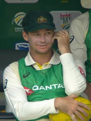 Peter Handscomb has a message delivered to him before entering the field of play to chat with Cameron Bancroft.