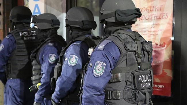 Bikie raid: Officers of Strike Force Raptor raid a premises in Sydney. Picture: AP