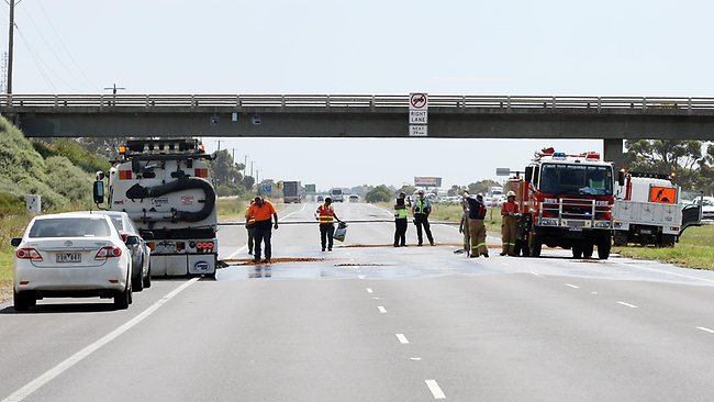 Emergency service workers clean up the Princes Hwy after the death of five people. Picture: Norm Oorloff