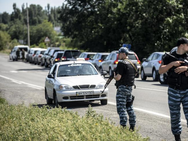 Setback ... a convoy of Dutch and Australian forensic teams try to make their way to the crash site of downed Malaysia Airlines flight MH17 on July 28. Picture: Bulent Kilic