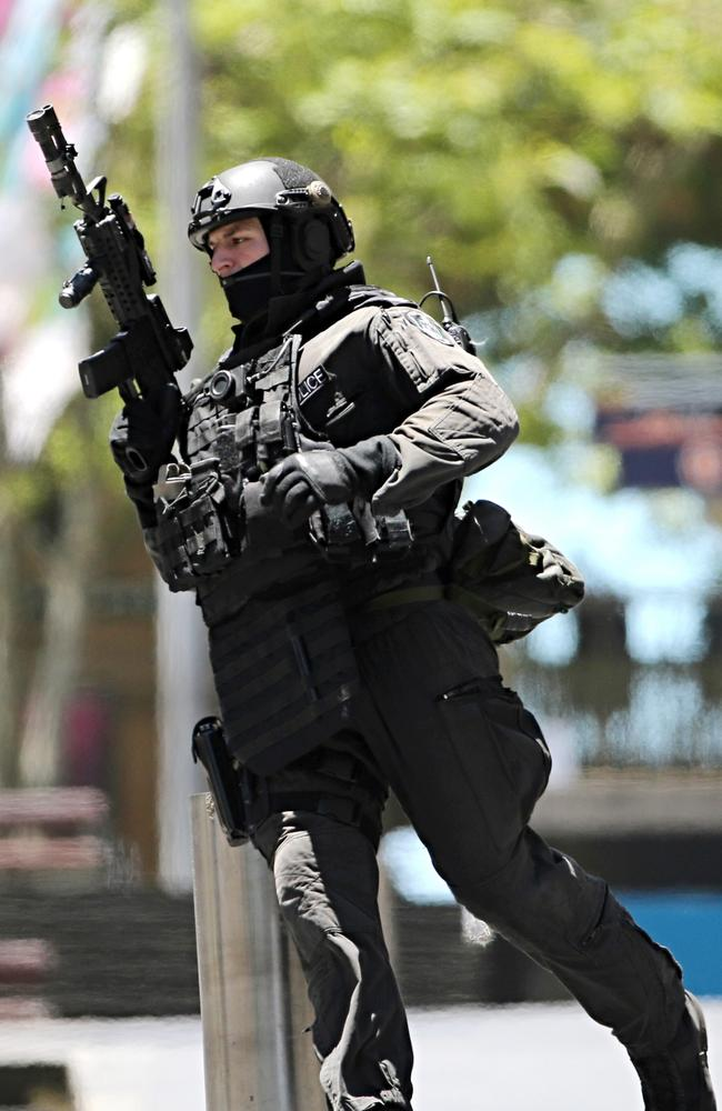 Elite squad … An armed police officer in action during yesterday's standoff. Picture: AP Photo/Rob Griffith
