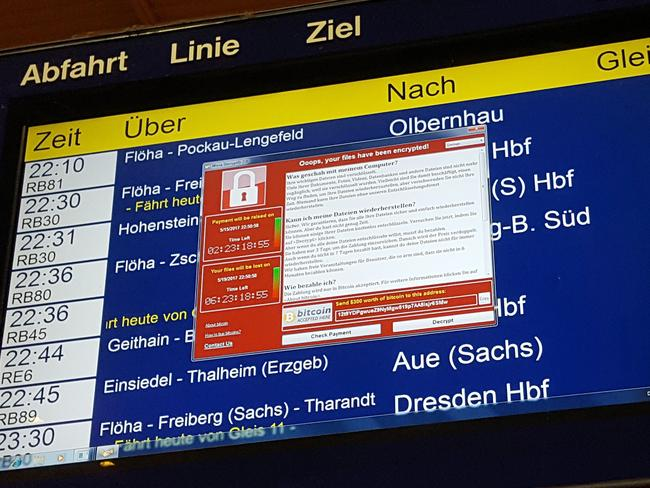 A window announcing the encryption of data including a requirement to pay appears on an electronic timetable display at the railway station in Germany. Picture: AFP/dpa/P. Goetzelt