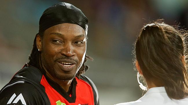 Chris Gayle of the Melbourne Renegades gives a TV interview to Mel Mclaughlin.