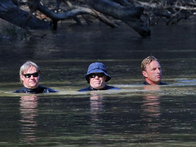Victorian police divers search the Murray River. Picture: Hamish Blair