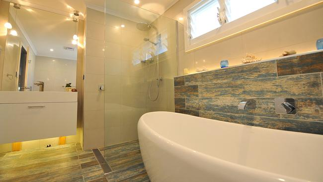 Fit for Royalty ... The amazing main bathroom and Maddi and Lloyd's renovated Pallarenda home.