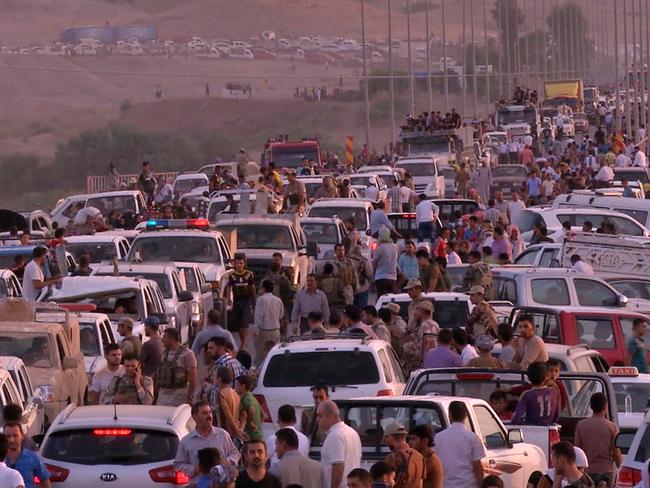 Iraqi people from the Yazidi community arrive in Irbil in northern Iraq after Islamic militants attacked the towns of Sinjar and Zunmar. Picture: AP/video
