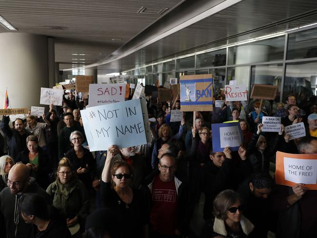 Demonstrators hold signs during a rally against a ban on Muslim immigration at San Francisco International Airport. Picture: Getty