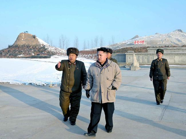 This undated picture, released in 2012 shows North Korean leader Kim Jong Un inspecting the planned construction site for the Pyongyang 'Folk Park'.