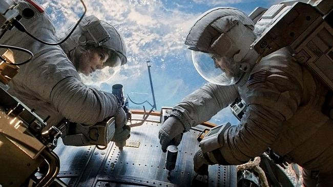 """Sandra Bullock and George Clooney in """"Gravity"""". She looks sober here."""