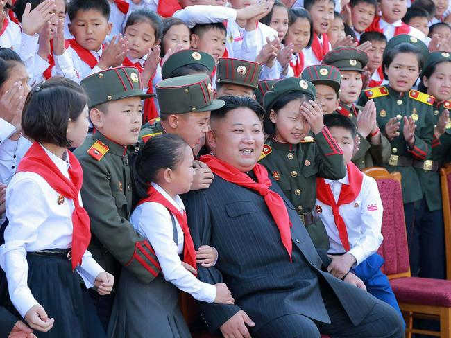 North Korean leader Kim Jong-un (C) with North Korean kids. Picture: AFP