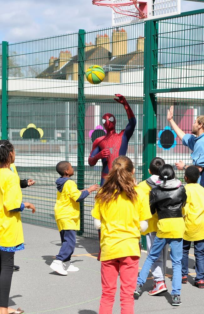 Basketball Marvel ... Spider-Man actor Andrew Garfield plays basketball with children from a kids charity in London. Picture: Gareth Cattermole